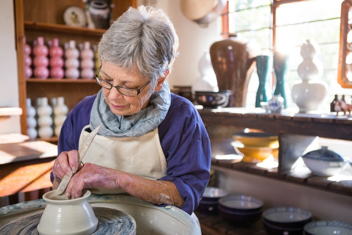 old woman crafting in a ceramics studio