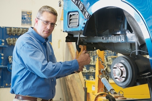 Auto repair and paint shops often employ fume extraction systems to prevent paint fumes from affecting worker health.